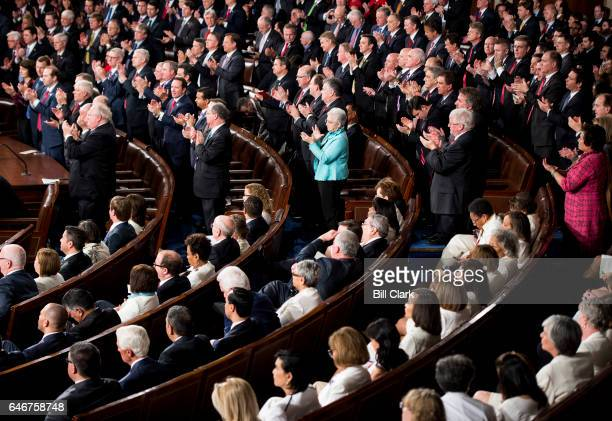 Democrats stay seated as Republicans give a standing ovation during President Donald Trump's address to a joint session of Congress on Tuesday Feb 28...