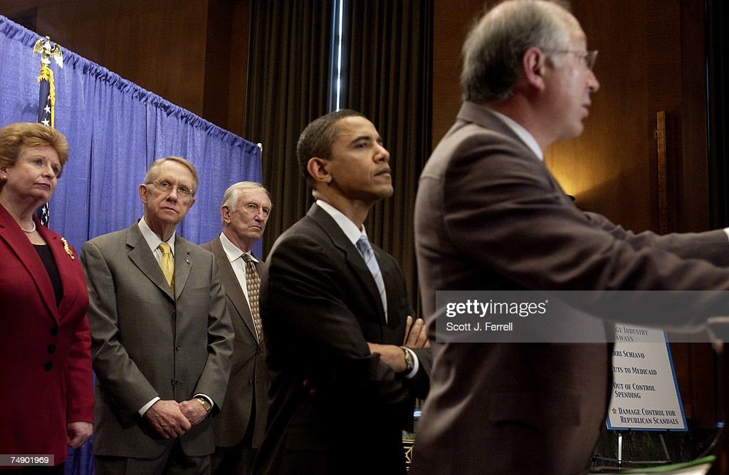 DEMOCRATS--Sen. Debbie Stabenow, D-Mich., Senate Minority Leader Harry Reid, D-Nev., and Sen. James M. Jeffords, I-Vt., look on with other Senate Democrats as Sen. Barak Obama, D-Ill., and Sen. Ken Salazar, D-Colo., speak during a news conference on the Democratic agenda.