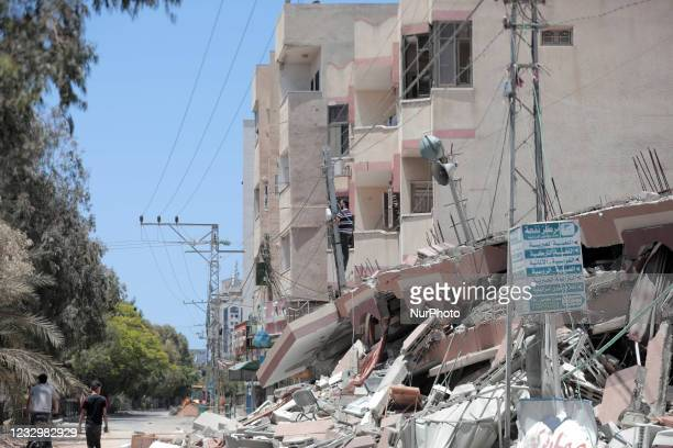 Demolished 6-storey building in Al-Rimal neighborhood contains libraries, youth centers, training for university students, and a mosque that was...