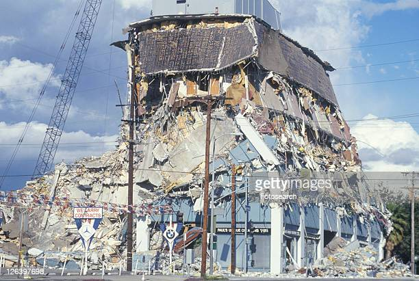 a demolished building at olympic blvd after an earthquake - demolishing photos stock photos and pictures