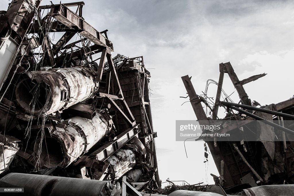 Demolished Building On Field Against Sky During Sunny Day : Stock Photo