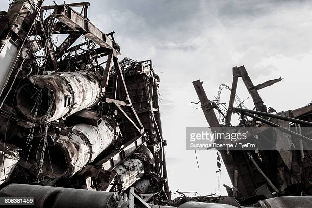 demolished building on field against sky during sunny day - collapsing stock pictures, royalty-free photos & images