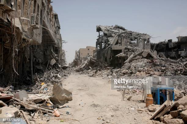 Demolished buildings and wrecked cars are seen after Mosul completely freed from Daesh in Mosul Syria on July 9 2017 Mosul was captured by Daesh...