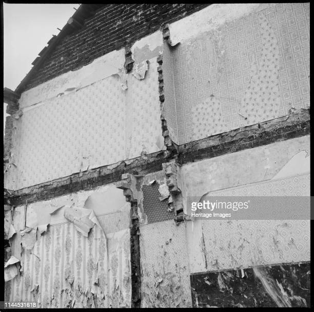 Demolished houses StokeonTrent 19651968 Detail of wallpaper exposed on a formerly internal wall of a row of partially demolished houses This site is...