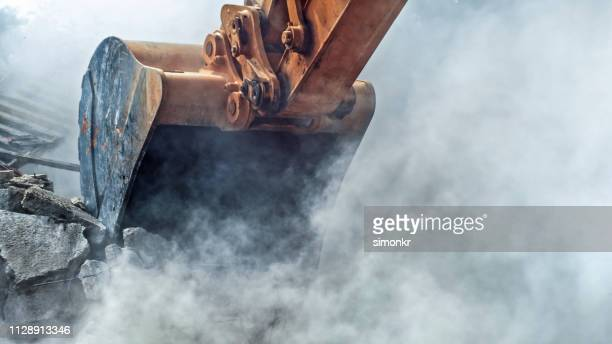 demolishing building - earth mover stock pictures, royalty-free photos & images
