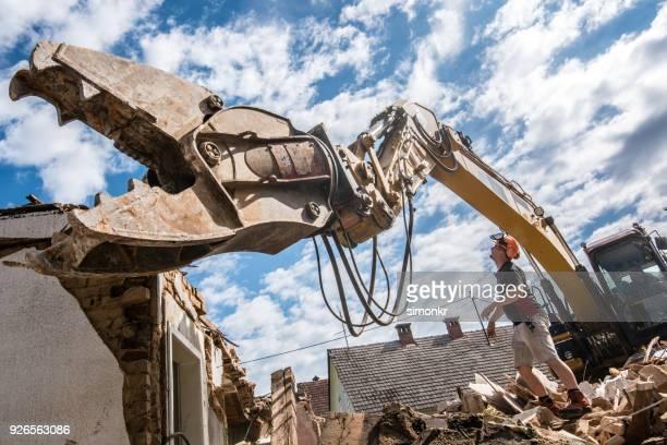 demolishing building - demolishing stock photos and pictures