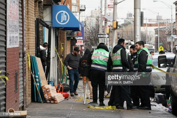 A demolition and recovery crew works at the scene of the December 10 2019 shooting at a Jewish Deli on December 11 2019 in Jersey City The shooters...