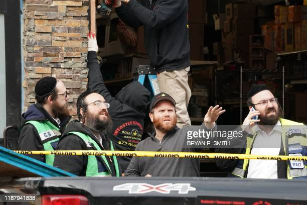 A demolition and recovery crew works at the scene of the December 10 2019 shooting at a Jewish Deli on December 11 2019 in Jersey City New Jersey The...
