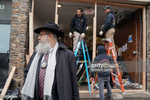 Demolition and recovery crews work at the scene of the December 10, 2019 shooting at a Jewish Deli, on December 11, 2019 in Jersey City, New Jersey.....
