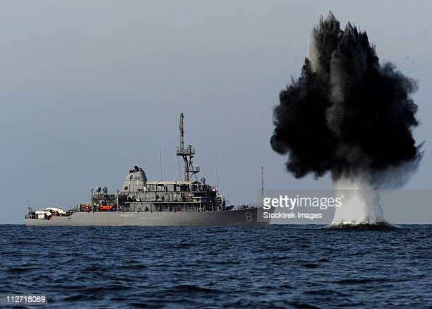 A demolition charge detonates 1,500 meters in front of USS Scout.