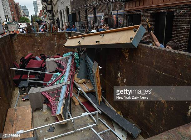 """Demolition crew throws """"Late Show with David Letterman"""" into dumpster at the Ed Sullivan Theater."""