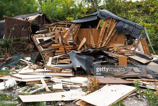 demolition of a wooden hut - house collapsing stock pictures, royalty-free photos & images