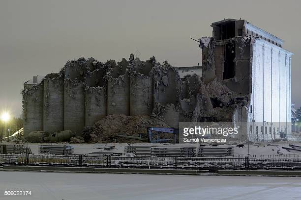 demolition of an old silos - silo stock photos and pictures
