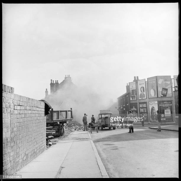 Demolition work in progress Lichfield Street Hanley StokeonTrent 19651968 People standing watching the demolition of houses on the east side of...