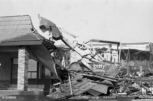 Demolition worker Doug Starr prepares to take a bulldozer bite out of the McDonald's restaurant in San Ysidro where 21 people were killed by a lone...