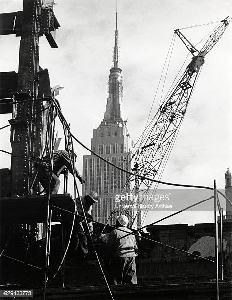 Demolition Workers Removing Remains of Pennsylvania Station with Empire State Building in Background New York City USA 1966