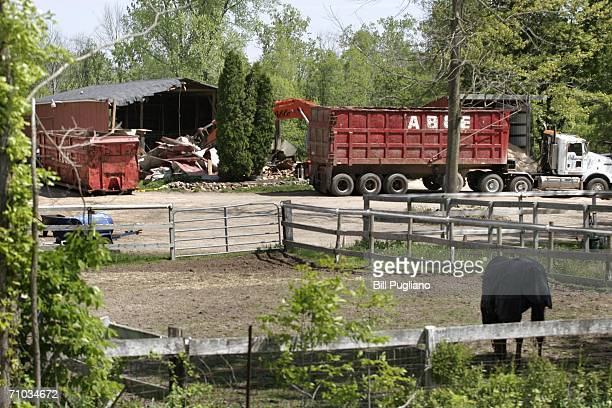 Demolition workers tear down a horse barn for the FBI during the search for former Teamster's Union president Jimmy Hoffa's body at the Hidden Dreams...