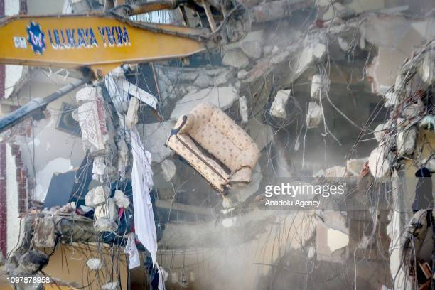 Demolition works of Yunus Apartment a tenstory building that is at risk of collapse continue next to Wednesday's collapsed building in Kartal...