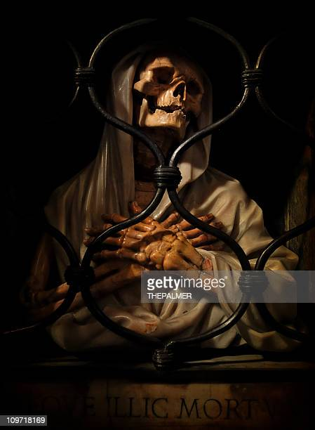 demon behind bars - crypt stock photos and pictures