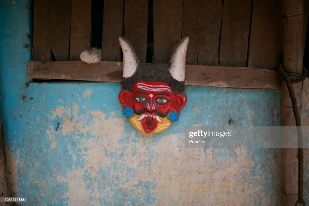 Demon mask on the wall : Stock Photo