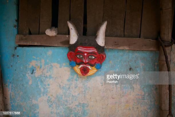 demon mask on the wall - devil costume imagens e fotografias de stock