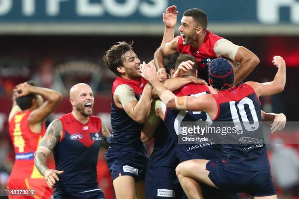 Demons celebrate winning the round eight AFL match between the Gold Coast Suns and the Melbourne Demons at Metricon Stadium on May 11 2019 in Gold...