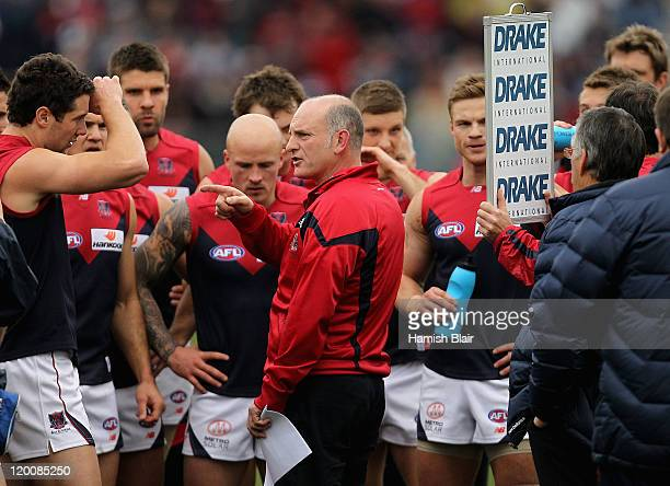 Demons coach Dean Bailey addresss his team at quarter time during the round 19 AFL match between the Geelong Cats and the Melbourne Demons at Skilled...