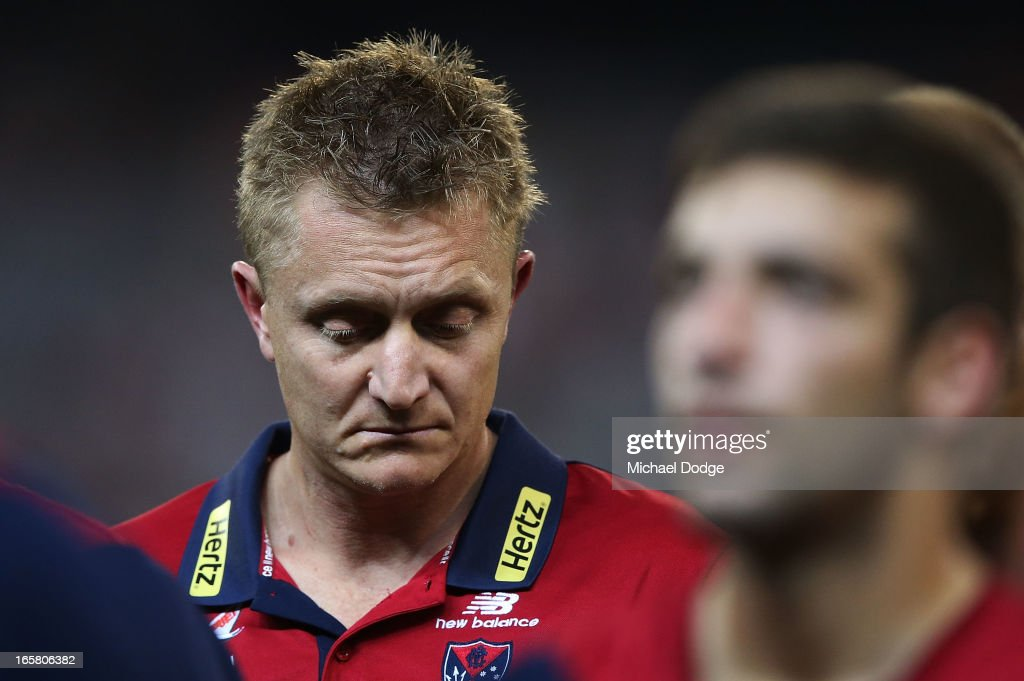 Demons coach Mark Neeld during the warm up before the round two AFL match between the Essendon Bombers and the Melbourne Demons at Melbourne Cricket Ground on April 6, 2013 in Melbourne, Australia.