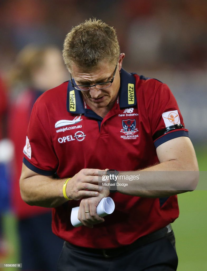 Demons coach Mark Neeld looks at his watch at three quarter time during the round two AFL match between the Essendon Bombers and the Melbourne Demons at Melbourne Cricket Ground on April 6, 2013 in Melbourne, Australia.