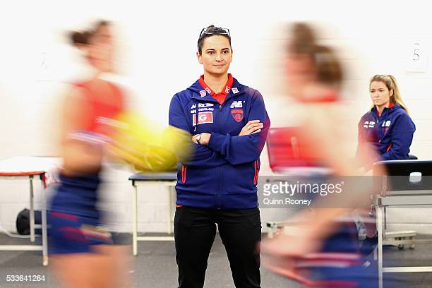 Demon's head coach Michelle Cowan watches on as players warm up ahead of the women's AFL match between the Melbourne Demons and the Brisbane Lions at...