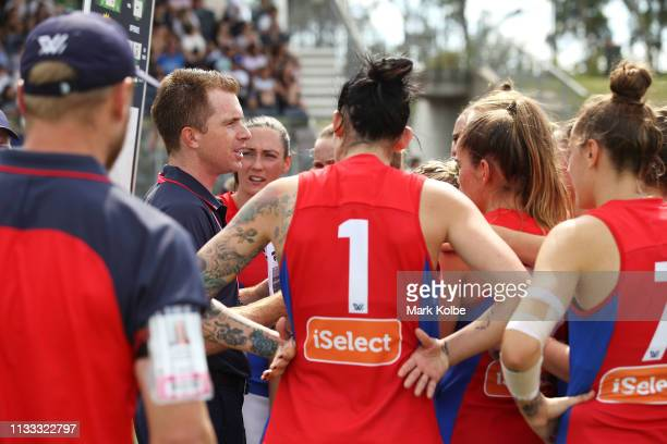 Demons head coach Mick Stinear speak to his team at three quarter time during the round five AFLW match between the Greater Western Sydney Giants and...