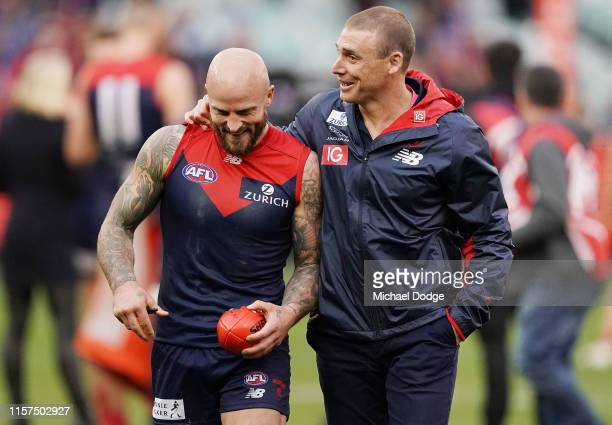 Demons head coach Simon Goodwin celebrates the win with Nathan Jones of the Demons during the round 14 AFL match between the Melbourne Demons and the...