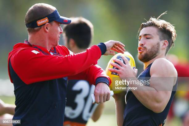 Demons head coach Simon Goodwin purposely bumps into Jack Viney of the Demons during a Melbourne Demons AFL training session at AAMI Park on May 9...