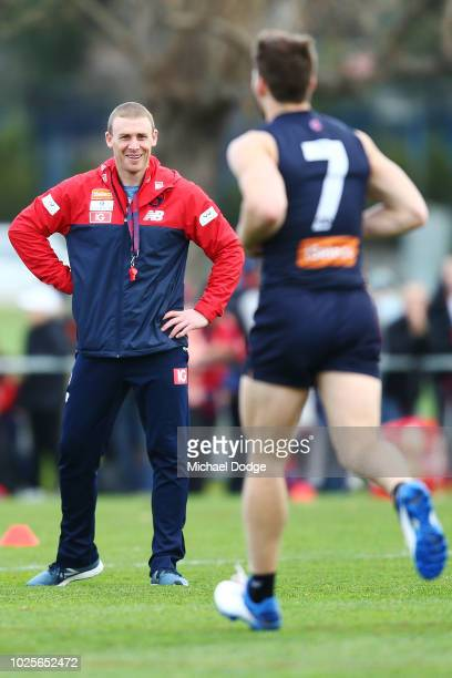 Demons head coach Simon Goodwin reacts as Jack Viney of the Demons finally comes back into full training for the first time since injury during a...