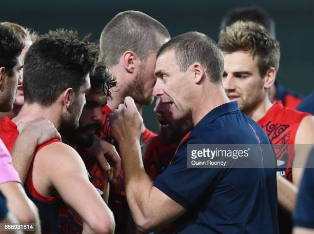 Demons head coach Simon Goodwin speaks to his players during the round ten AFL match between the Melbourne Demons and the Gold Coast Suns at Traeger...