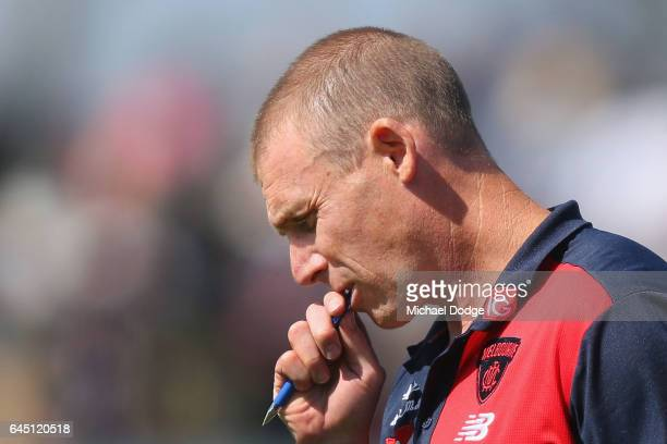 Demons head coach Simon Goodwin walks off at at three quarter time during the JLT Community Series AFL match between the Melbourne Demons and the...