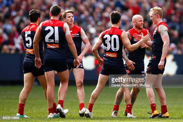 Demons players celebrate a goal during the round 21 AFL match between the Melbourne Demons and the St Kilda Saints at Melbourne Cricket Ground on...