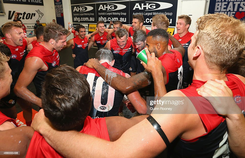 Demons players celebrate in the rooms after winning the round one AFL match between the Melbourne Demons and the Gold Coast Suns at Melbourne Cricket Ground on April 4, 2015 in Melbourne, Australia.