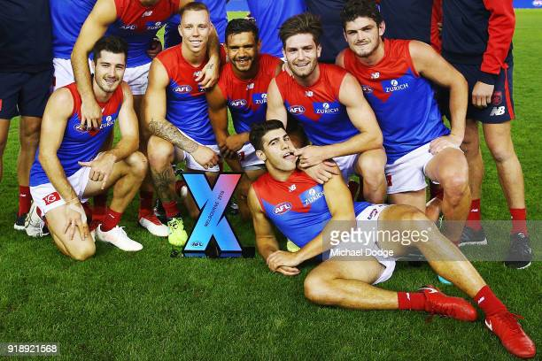 Demons players celebrate the win in the final during the AFLX match between Hawthorn Hawks and Melbourne Demons at Etihad Stadium on February 16 2018...