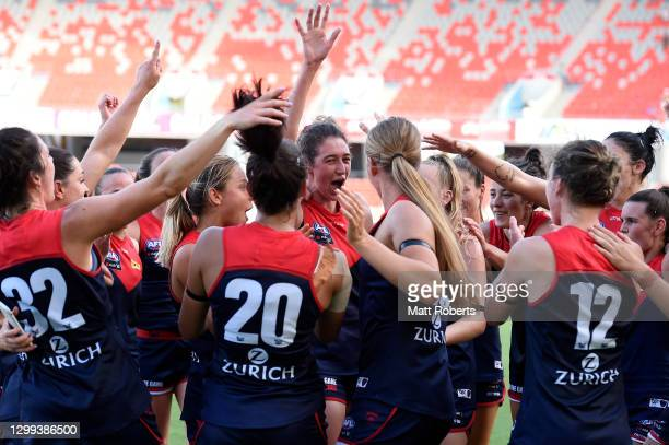 Demons players celebrates victory during the round one AFLW match between the Gold Coast Suns and the Melbourne Demons at Metricon Stadium on January...