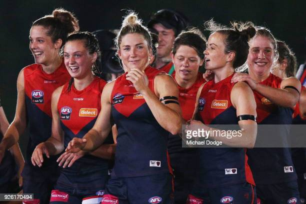 Demons players including Melissa Hickey and Daisy Pearce celebrate after winning during the round five AFLW match between the Melbourne Demons and...