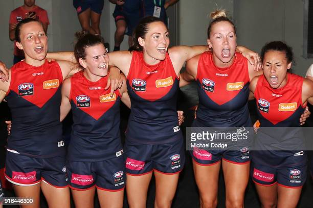Demons players sing the club song after winning during the round two AFLW match between the Melbourne Demons and the Adelaide Crows at Casey Fields...