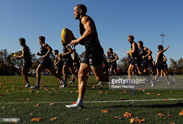 Demons players warm up during a Melbourne Demons AFL training session at Gosch's Paddock on May 9, 2013 in Melbourne, Australia.