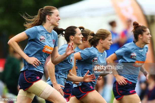 Demons players warm up during the round two AFLW match between the Melbourne Demons and the Adelaide Crows at Casey Fields on February 10 2018 in...