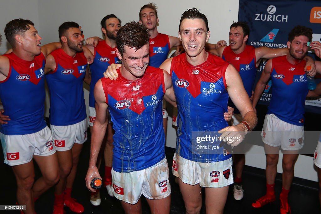 Demons sing the team song after winning the round two AFL match between the Brisbane Lions and the Melbourne Demons at The Gabba on March 31, 2018 in Brisbane, Australia.