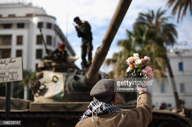 Demonstartor offers flowers to soldiers on their tank as an un-easy peace hangs over Tunisia on January 21, 2011 in Tunis, Tunisia. Tunisians have...