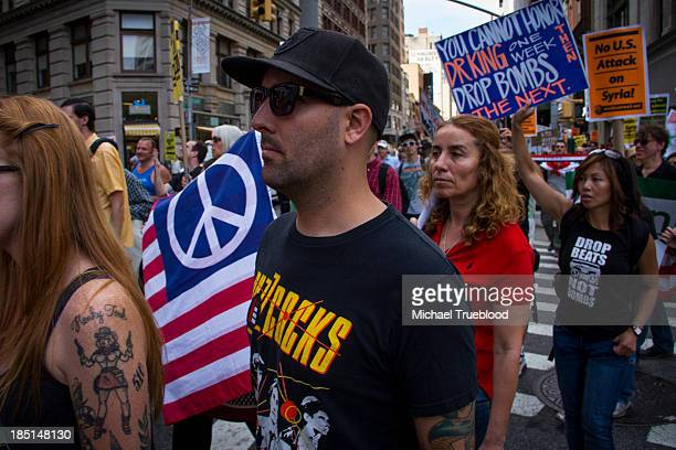 Demonstaters march from Times Square to Union Square in New York City in protest of possible US military action in Syria.