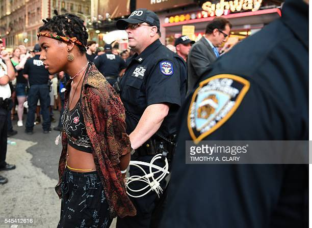 Demonstators are arrested by NYPD after they march through the city and call for justice for Alton Sterling and Philandro Castile in the middle of...