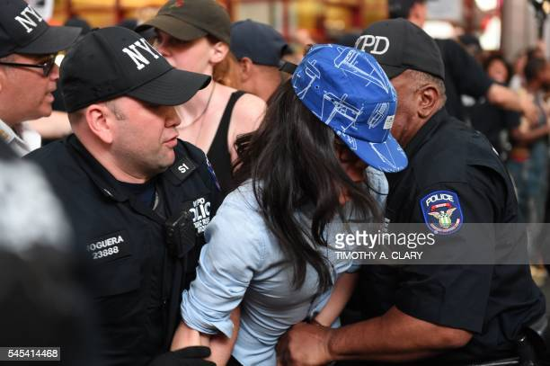 TOPSHOT Demonstators are arrested by the NYPD after they march through the city and call for justice for Alton Sterling and Philandro Castile in the...