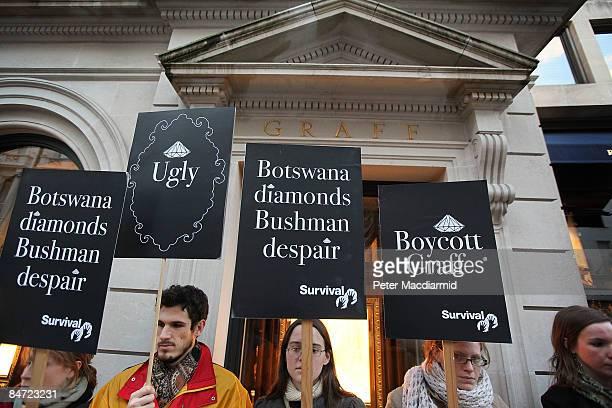 Demonstators hold placards outside Graff diamonds on February 10 2009 in London Survival International protestors standing outside Graff Diamond's...